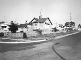 Slocan Street, west side, 5th to 6th Avenues - view northwest
