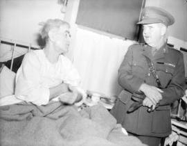 [Lieutenant Governor W.C. Woodward visits a patient in  Queen Victoria hospital during the] Golde...