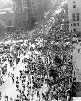 [View looking east along Georgia Street near Burrard Street of the crowds dispersing after the Di...