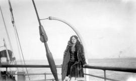 [Woman standing on the deck of a boat]