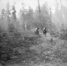 [View of Bob Arnott and Ted Campbell on horseback]