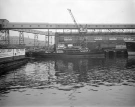 "[B.C. Telephone cable barge, the ""Brico"", at a CPR pier]"
