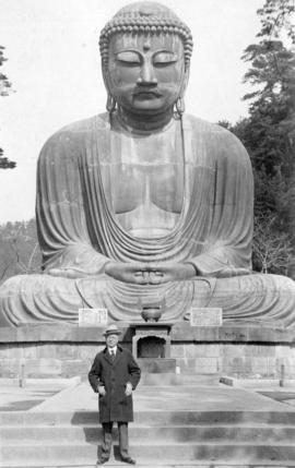[L.D. Taylor standing in front of a buddha statue in] Kamakura Japan - old capital