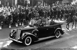 [King George VI and Queen Elizabeth in car at the corner of Granville Street and Dunsmuir Street]