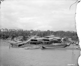 [Boats and buildings on beach at Cates Shipyard, near the south end of Burrard Street at False Cr...