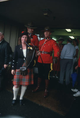Bagpipe player and Mounties at the Centennial Commission's Canada Day celebration
