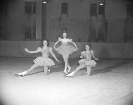 [Three young skaters at the Rotary Ice Carnival]