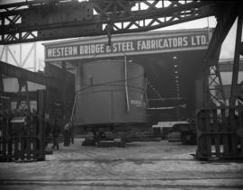 [Large metal cylinder inside the Western Bridge and Steel Fabricators Ltd. warehouse]