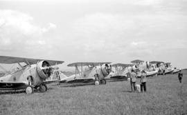 [Row of navy biplanes]