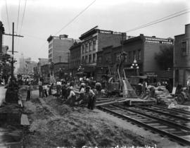 [Men laying streetcar tracks at Granville and Drake Streets, for reconstruction of Granville Stre...