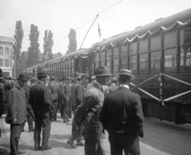 [Men on platform outside interurban railway cars decorated for opening at Saanich Interurban Rail...