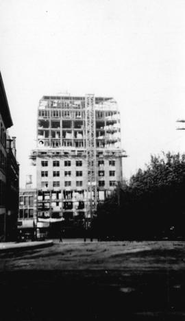 [View of the Dominion Trust building under construction]