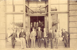 [Group portrait in front of Rand Bros. Real Estate office - 100 Cordova Street]