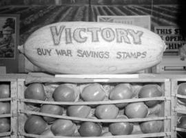 [Fruit display with a decorated watermelon advertising war savings stamps]