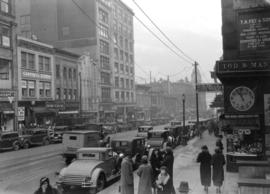 [Looking north along the west side of the 500 Block of Granville Street towards the] C.N.R. Building