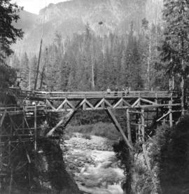 [View of women standing on the second bridge over Capilano Canyon]
