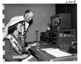 Miss P.N.E., Joan Greenwood, with radio equipment in P.N.E. Press Radio building