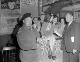 Chinese[-Canadian soldier at a Victory Bond promotion]