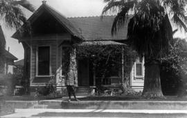 [Theodore Taylor standing in front of home at 1420 Catalina Street, Los Angeles]