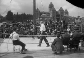 Len Holliday boxing at New Westminster [outdoors]