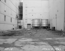Liquid sugar station construction; tanks in place; anchors on north wall for purlins