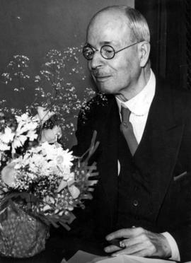 Mayor L.D. Taylor with vase of flowers