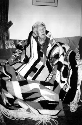 Edward Sparrow wrapped in a large Salish blanket woven for the Vancouver airport in 1995-96 by hi...