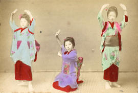 [Studio portrait of three young women dancing in traditional Japanese dress]