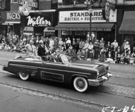 Vancouver Mayor F.J. Hume and P.N.E. President J.S.C. Moffitt waving from car in 1953 P.N.E. Open...