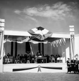 P.N.E. President M. Bowell speaking on stage at 1947 P.N.E. opening ceremonies
