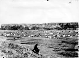 """The Camp"" showing sitting figure at Great Indian Sun Dance, Blackfoot Reserve, Gleiche..."