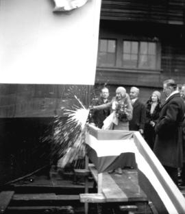 "Launching of Shelly's new boat ""Cora Marie"", christened by Miss Shelly"