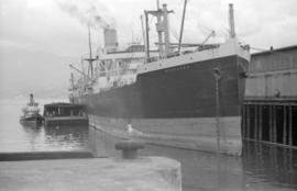 "[Freighter ""Nebraska"" at dock]"