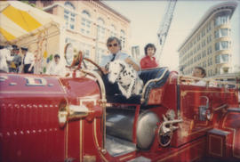 Driver and dalmatian in red fire engine