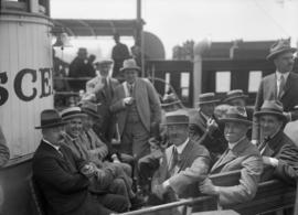 "[Men seated and standing aboard the ""Scenic"" excursion boat]"