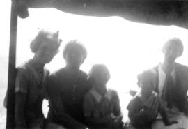 Group portrait on boat with Jane Banfield and John Banfield in centre