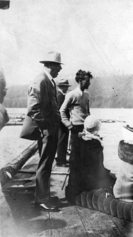 [L.D. Taylor watching event from dock at Port Moody]