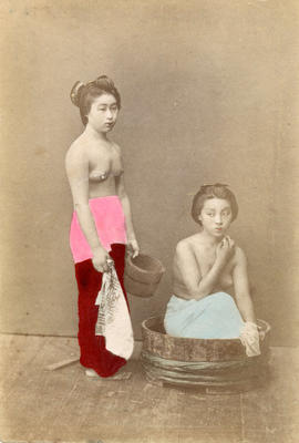 [Studio portrait of two topless women in formal Japanese dress]