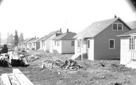 [View of almost completed houses built as part of a shipyard housing program in North Vancouver]