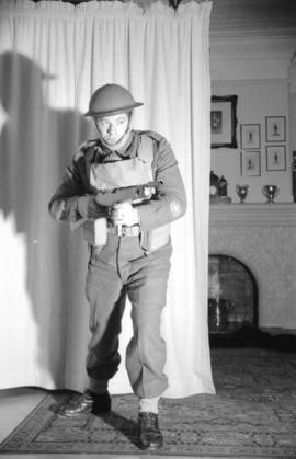 [Soldier with a tommy gun inside a house]