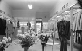 [Interior view of Mademoiselle Ltd. clothing store]