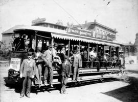 Conductors in front of Mount Pleasant open side streetcar with canvas flaps on side and Athlete C...