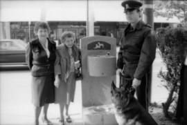 Unidentified woman, Theresa Galloway, Constable Rob Bosley and police dog Sport at drinking fount...
