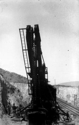 Filling the trestle at Mile 2.2 K.V.R. : The boom of the shovel