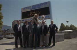 Group of men with Cats cast members in front of the Queen Elizabeth Theatre Bank of Montreal sign...