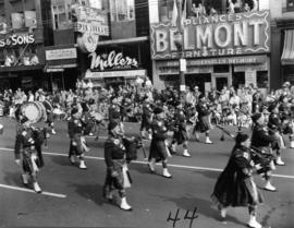 Pipe band marching in 1955 P.N.E. Opening Day Parade