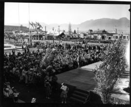 Crowd around Electrical building stage, with Livestock building in background