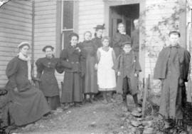 [Group portrait at back door of Fitzgerald McCleery's residence at D.L. 315 (2650 W. 50 Aven...