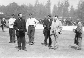 [Mayor T.S. Baxter addressing players at a sporting event at Hastings Park]