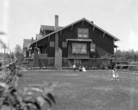 Mr. James and family in yard at 4377 West 14th Avenue